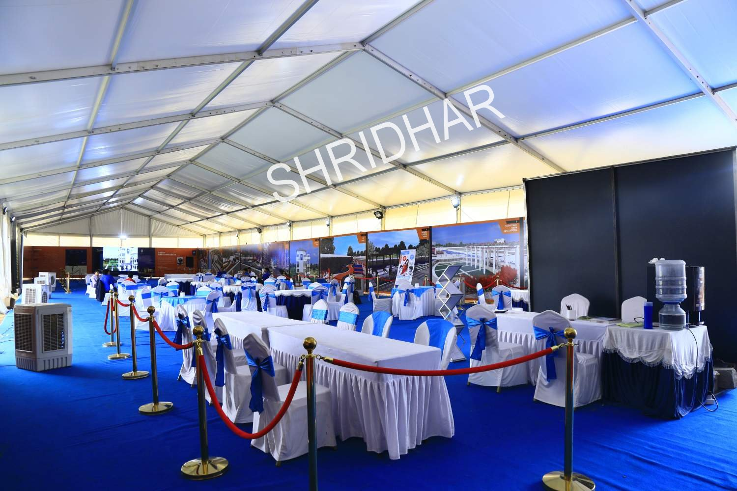 golden queue stands with red ribbons for rent for hire in bangalore shridhar tent house